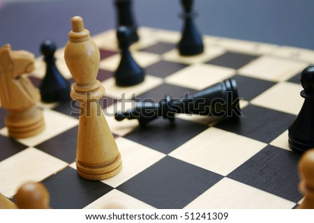 Wood chess game shows win and lose. - stock photo