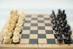 Wood chess pieces on a board