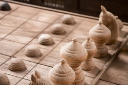 wood chess pieces on board game. brown wood vintage  background.