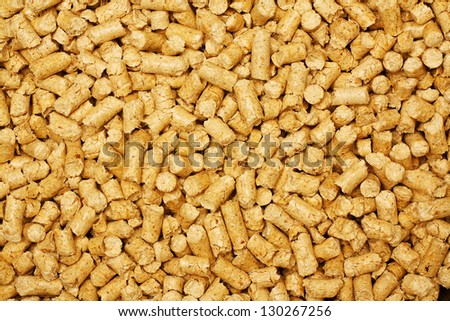 wood chip pellets a renewable source of energy becoming popular as a green environmentally friendly fuel for stoves which provide household heating