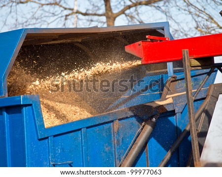 Wood Chipper Machine Filling Back Of Truck With wood chips