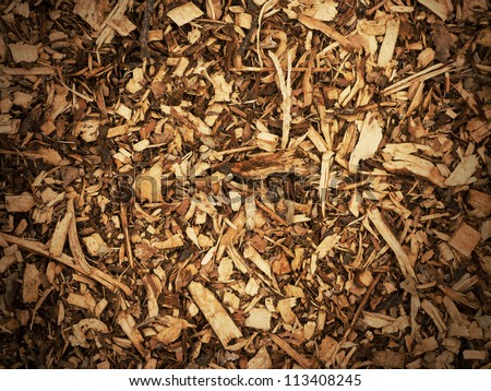 Wood chips background with vignette
