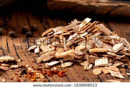 Wood chips for smoking meat or fish on an old wooden table close-up. ストックフォト ©