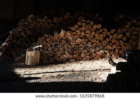 Wood chopping splitting with really dramatic light