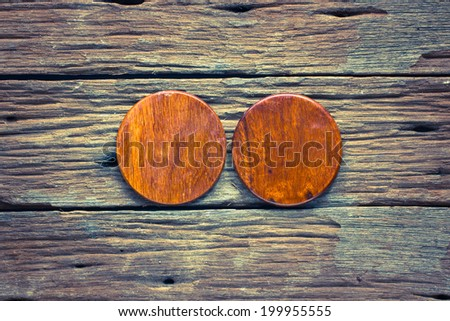 Wood circle cutting board on old wooden background