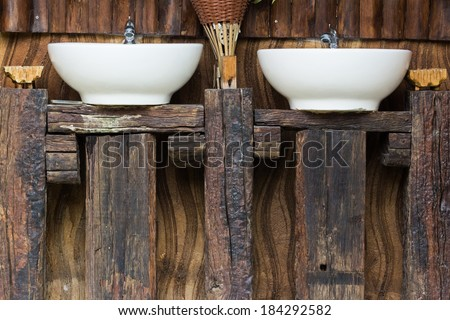 Wood counter and hand washing sinks outside the toilet
