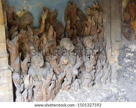 Photo of  Wood craft There is the purgatory made of carved  wood figures