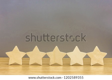 Wood cube five star shape on wooden table gray background. Block 5 stars rated  best  service  excellence concept. Excellence customer vote quality satisfaction winners award.  #1202589355