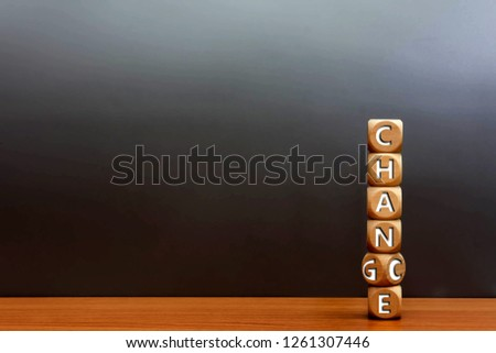Wood cube stacked chance or change on wooden table with gray background.  This mindset increases your chance of achieving success. Personal development opportunities and improvement concept.  #1261307446