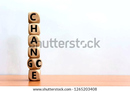 Wood cube stacked chance or change on wooden table with white background.  This mindset increases your chance of achieving success. Personal development opportunities and improvement concept.