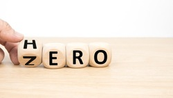Wood cube zero or hero on wooden table wooden white background.  Concept winner and loser effect.