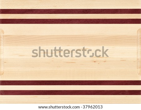 Wood cutting board with different color wood strips.