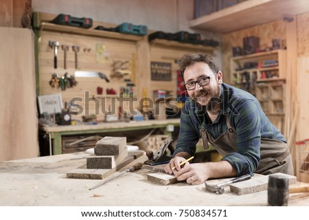 Wood designer working in workshop. #750834571