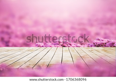 Wood desk and empty space for adverstisement display with Pink flower field  against with sunlight Photo stock ©