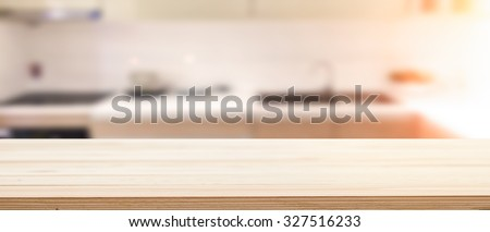 wood desk space and kitchen background. for product presentation.