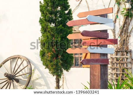 Wood direction sign, empty boards pointing towards different directions - image #1396603241