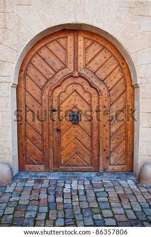 Wood door with cobblestone road. Detail from the streets of Prague.