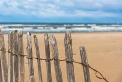 Wood fence on the beach