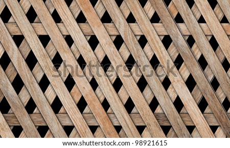 wood fence weave on black background - stock photo