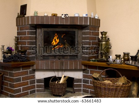 Wood fire in an old style wooden log cabin.