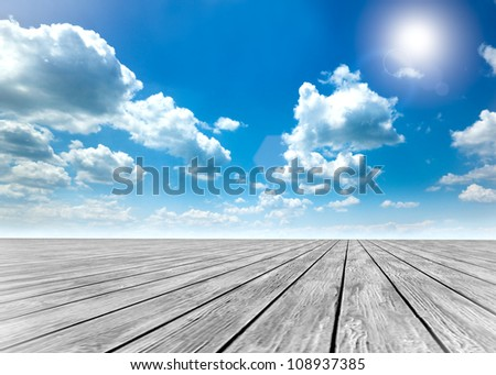 wood floor and blue sky background