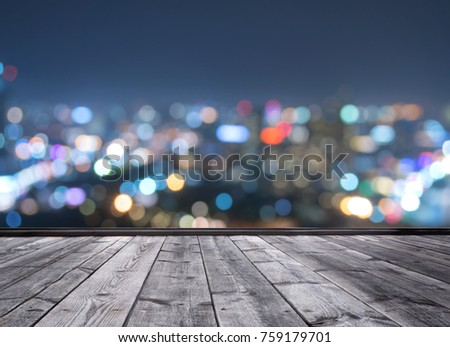 wood floor and blurred city light background #759179701