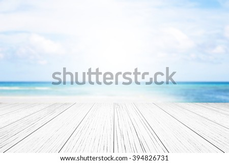 wood floor background blurred ocean beach abstract style.Light center of the image concept, ideas differ. #394826731