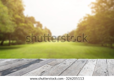 Wood floor top on blurred city park background #326205113