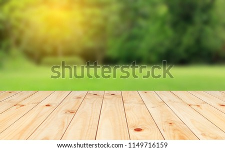 Wood floor with blurred trees of nature park background and summer season, product display montage #1149716159