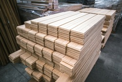 wood flooring planks stored in wood processing factory