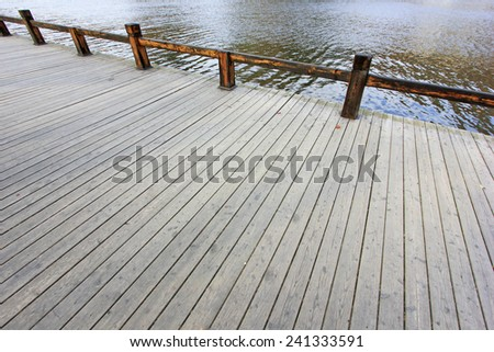 Wood floors and railings in the park, closeup of photo