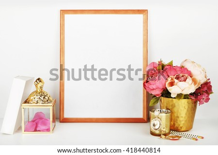 Wood frame with gold vase and gold items. Frame mock-up. #418440814