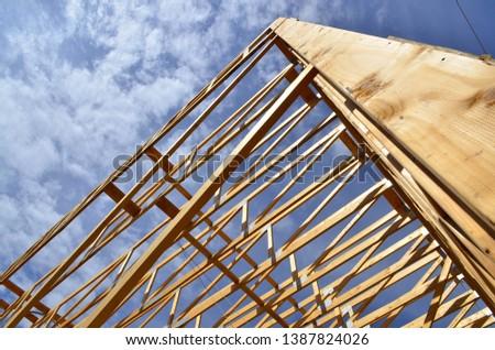 Wood framework of commercial building under construction.