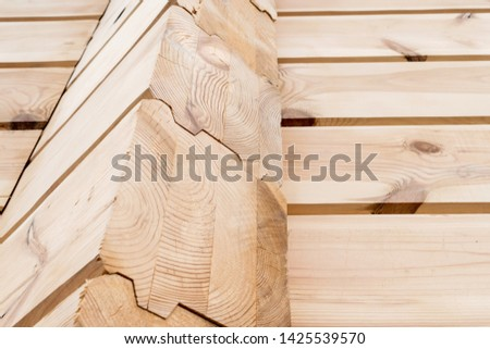 Wood Glued timber close up background. Wooden construction glued laminated timber in the wall of the house. Glued beams. Wooden beams in the groove.