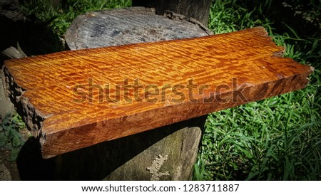 Wood has tiger stripe or curly stripe grain, Afzelia wood exotic beautiful pattern for crafts or abstract art Background texture #1283711887