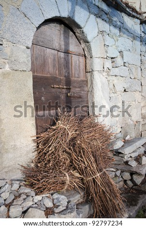 wood in front of a door on the alps