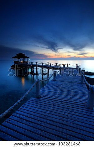 Wood jetty in  the beach at the sunset, Koh Kood at Trat of Thailand - stock photo