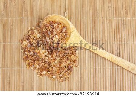 wood ladle sugar , rock sugar and wood ladle on japanese mat.