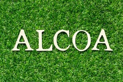 Wood letter in word ALCOA (Abbreviation of Attributable, Legible, Contemporaneous, Original and Accurate) on green grass background