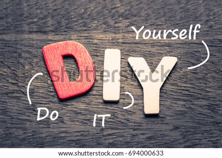 Wood letters of DIY and definition on wood background