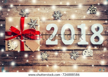 Wood numbers forming the number 2018, For the new year 2018 on rustic wooden with gift box and snow and christmas decoration. #726888586