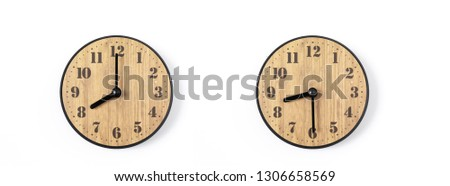 wood office wall clock with white dial on white background. wall clock on white background, top view. #1306658569