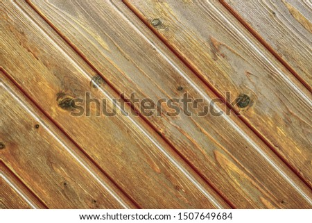 Wood panelling made of diagonally laid wooden panels in reddish brown colour