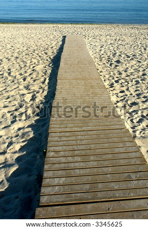 wood path to the water in the beach