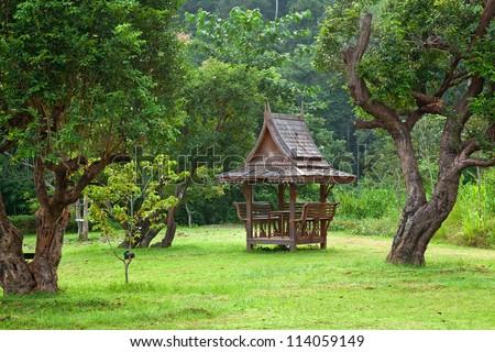 Wood pavilion in park, Thailand.