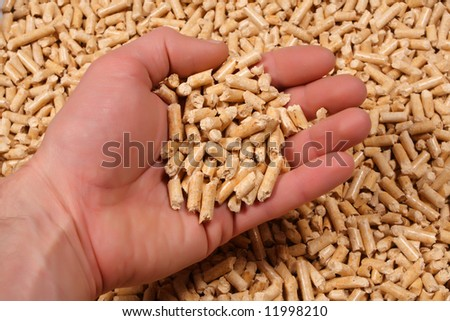 wood pelletand hand background