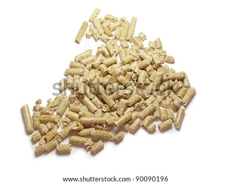 Wood pellets background close up. Isolated in white
