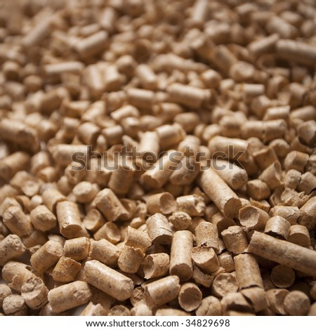 Wood pellets close-up texture background