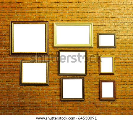 Wood photo frames on aged brick wall with blank white space