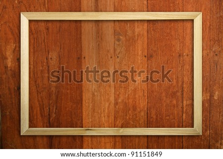 Wood picture frame on wood panel